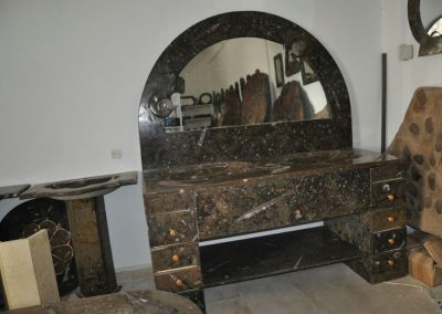 Black marble furniture with fossils