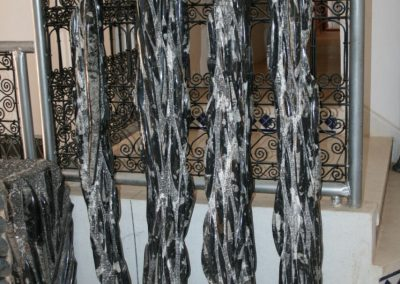 Black marble columns with nautiluses