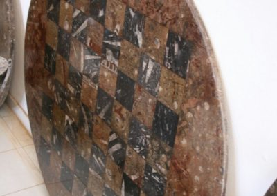 Table top with  marble chessboard and nautiluses