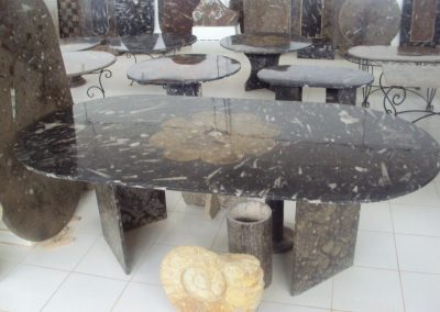 Black marble table with fossils